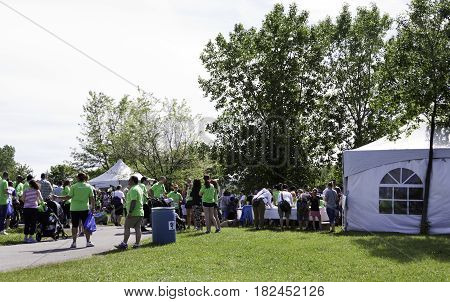 Laval, Quebec - June 14, 2015 - Landscape view of the entrance and sign-up tables at the