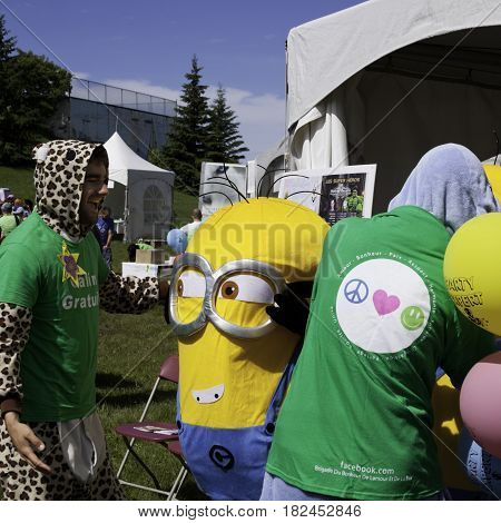 Laval, Quebec - June 14, 2015 - Square view of a volunteer laughing with a costumed Minion at the