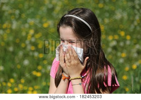 Young Girl With Brown Hair With Allergy To The Grasses Blows Her