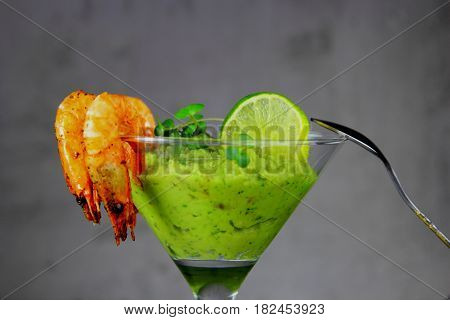 appetizer of avocado with lime and shrimp grill