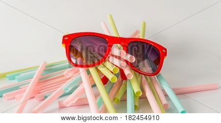 color straw drink and sunglasses straw object of drink white background party set