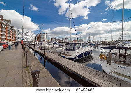 Ipswich, UK. 17th April 2017. People are walking along the marina in Ipswich on a sunny spring day