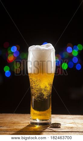 Glass Of Beer On Bar Lights Background