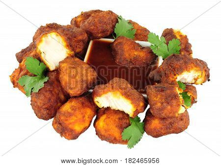 Group of fried chicken pakora with chilli sauce dip isolated on a white background