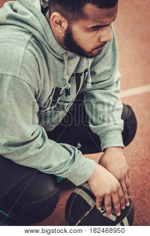 African-american streetball player resting.