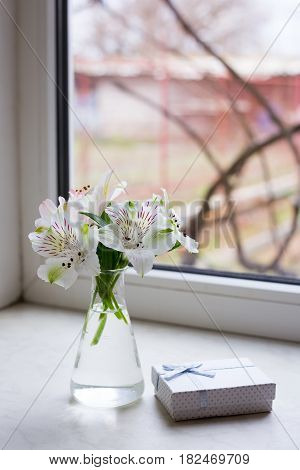 Beautiful Tender Bouquet Of Alstroemeria With White Gift Box Near Window