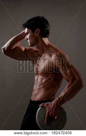 The muscular man is working on his abs.