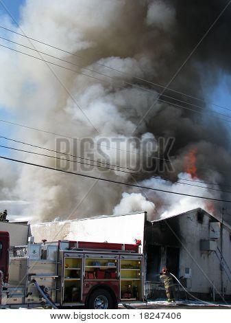smoke plume above burning building