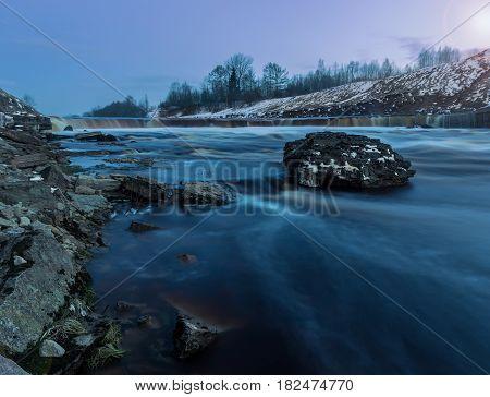 Twilight on the Tosnensky waterfall, Leningrad region, Russia