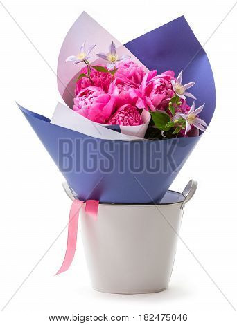 Bouquet of pink peonies wrapped in paper over white background