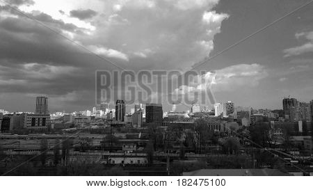 KIEV - UKRAINE - APRIL 2017: Panoramic view of the skyscrapers of Kiev against the background of the cloudy sky. Train Station Area. Monochrome photo