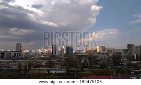 KIEV - UKRAINE - APRIL 2017: Panoramic view of the skyscrapers of Kiev against the background of the cloudy sky. Train Station Area