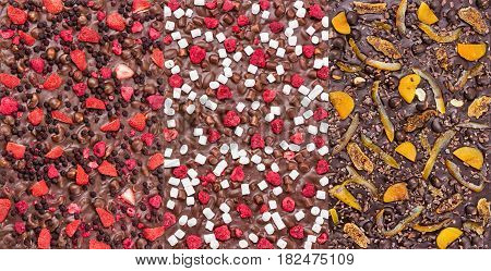 Three kinds of chocolate bars with dried berries fruit and nuts. Could be used as backgrounds.