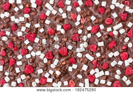 Milk chocolate bar with dried raspberries and marshmallow could be used as background