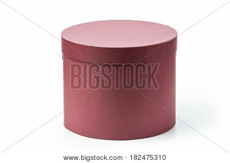 Closed round gift box over white background