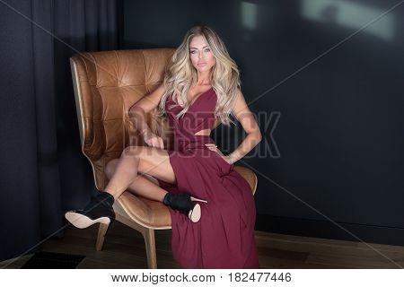 Blonde Woman Posing In Dress.