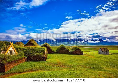 Farm Museum in Glaumbaer. The picturesque village of old houses covered with turf and grass. The concept of cultural and historical tourism