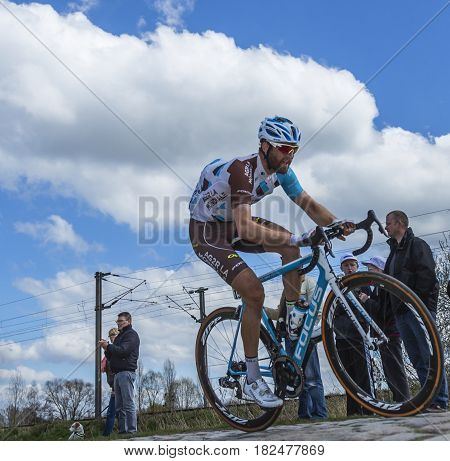 Hornaing France - April 102016: The Canadian cyclist Hugo Houle of AG2R La Mondiale Team riding in the peloton on a paved road in Hornaing France during Paris Roubaix on 10 April 2016.