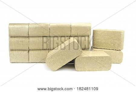 Wood briquettes ( pressed sawdust ) isolated on white background.