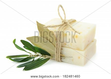 Natural herbal soaps with olive and bay leaf isolated on white background.
