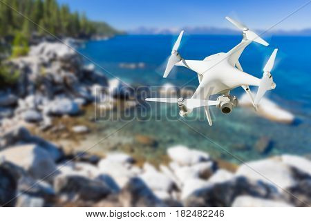 Unmanned Aircraft System (UAV) Quadcopter Drone In The Air Over Lake Tahoe.