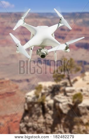 Unmanned Aircraft System (UAV) Quadcopter Drone In The Air Over The Grand Canyon.