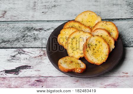Garlic Bread On Black Retro Plate