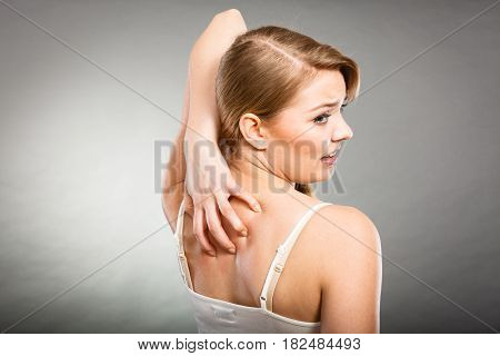 Woman Scratching Her Itchy Back With Allergy Rash