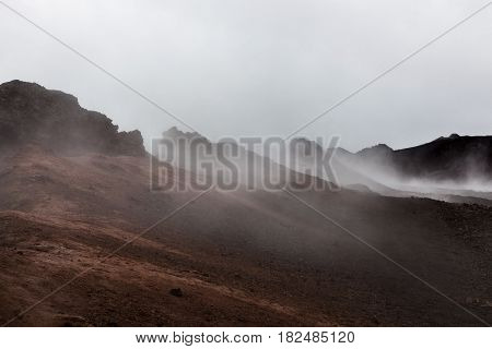Apocalyptic Smoking Red Landscape Of Krafla Crater. Red Lava Hills - Still Active Volcanic Area Near