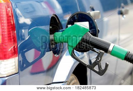 Pumping fuel in to the tank close up image