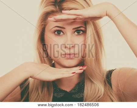 Portrait Of Blonde Woman With Hands Close To Face