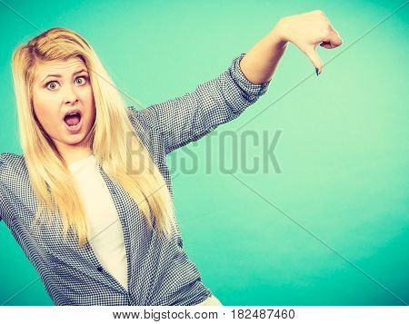 Unhappy Woman Showing Thumb Down Gesture