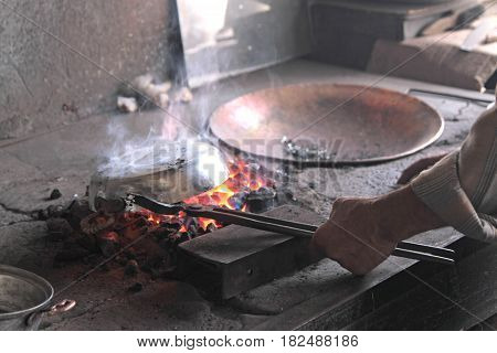 Traditional Turkish tinsmith or coppersmith close up image