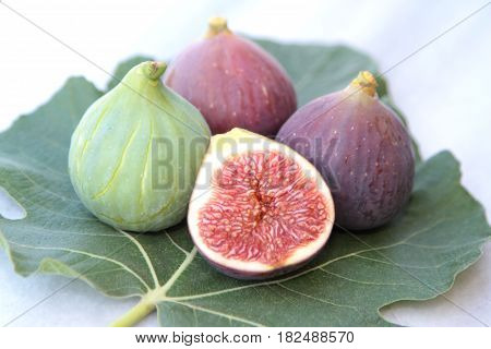 Delicious figs on a fig leaf close up image