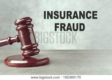 Insurance fraud concept. Judge's gavel on table
