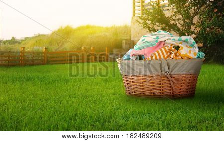 Wicker basket with baby laundry outdoor