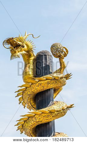 Dragon gold is made from scrap steel on blue sky background.