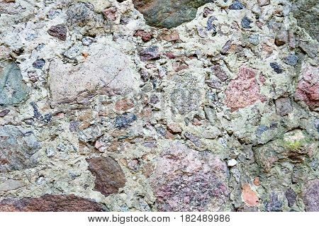 pattern gray color of modern style design decorative uneven cracked real stone wall surface with cement.