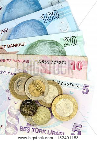 Turkish banknotes and coins on white background.