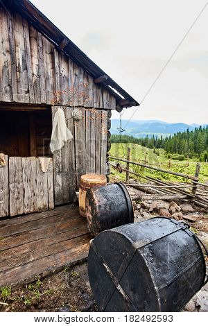 Mountain hut and vat for the production of cheese in Carpathian village