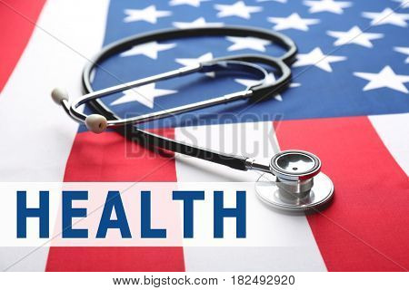 Word HEALTH and stethoscope on USA flag background