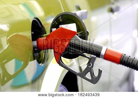 Pumping fuel with red pump, close up image