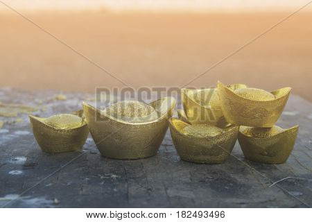 Chinese new year ornament--Stack of gold ingots on white background.