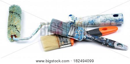 Used paint roller and brushes, isolated on white background