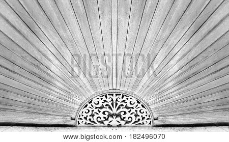 Wood carving pattern over the door of ancient Chinese style house at Trok Ban Chin Tak province Thailand