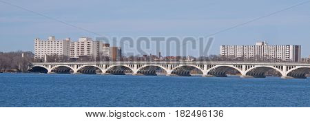 The MacArthur Bridge provides vehicle and pedestrian access from Detroit, Michigan to Belle Isle, a large state park in the Detroit River between the United States and Canada. It was completed in 1923 and is comprised of nineteen concrete cantilevered arc