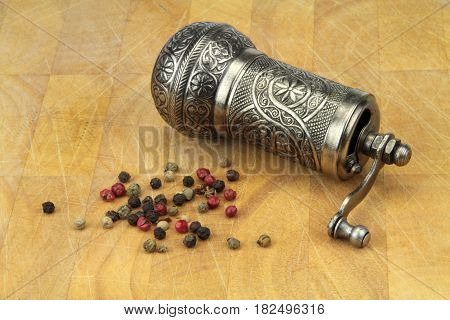 Pepper grinder and mixed peppers,close up  image