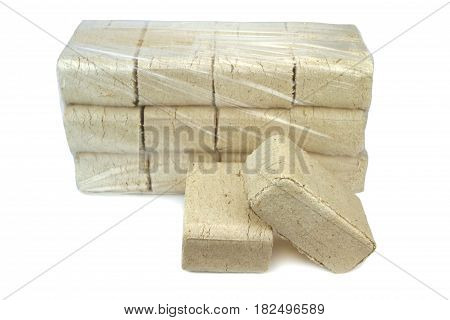 Wood briquettes isolated on white background .