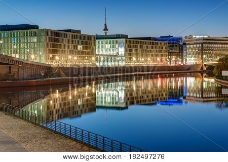 Office buildings at the river Spree in Berlin with the Television tower in the back