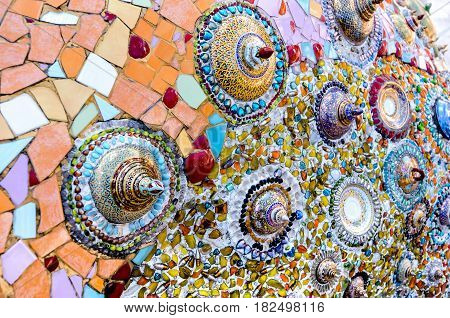 decoration colorful wall by cracked color glass and cracked color bowl in Thailand temple